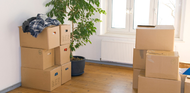 many stacked moving boxes in a room